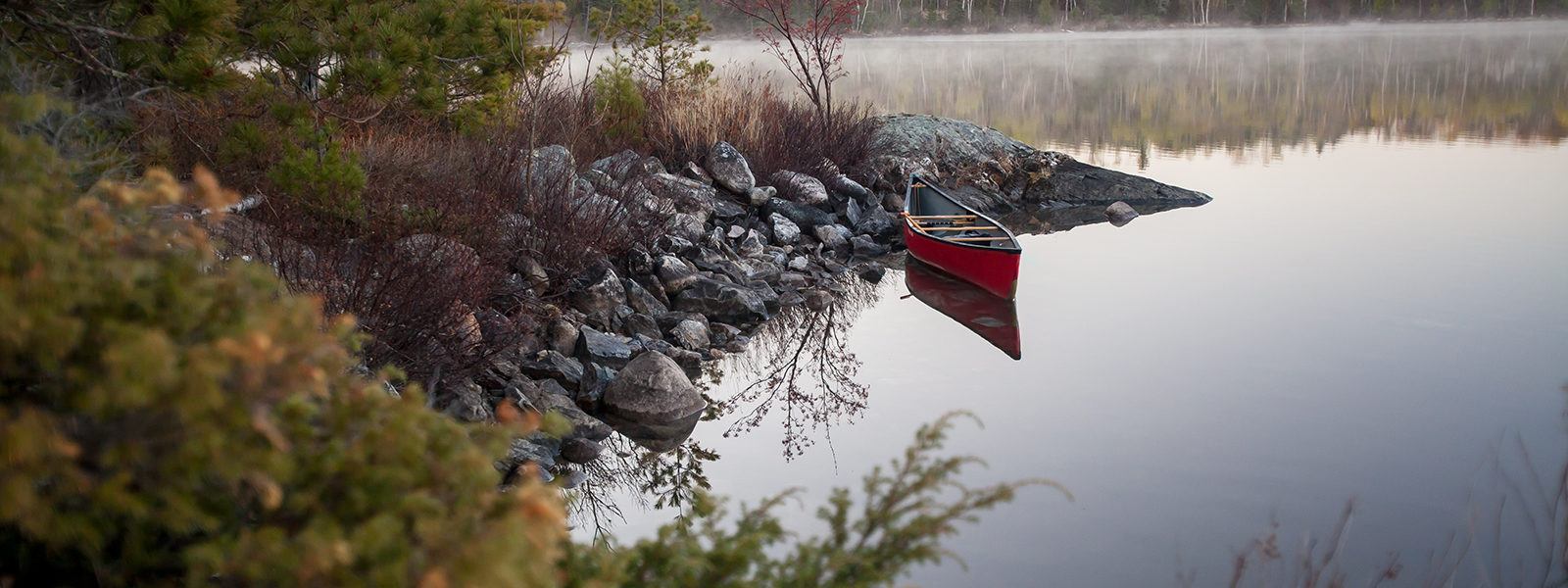 Red canoe on a lake