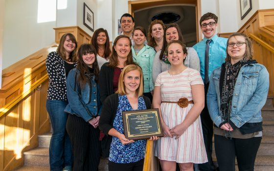 Northland students stand with award