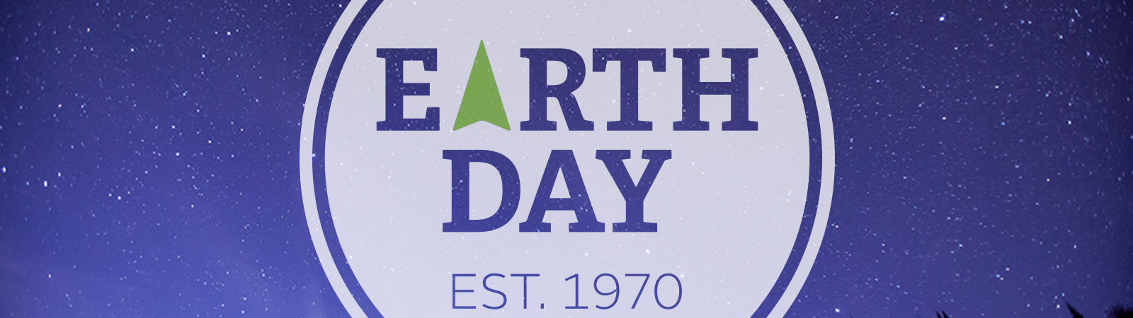 Earth Day badge over night sky