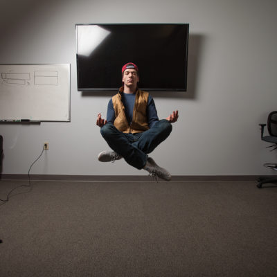 Northland College student levitating using photography tricks.
