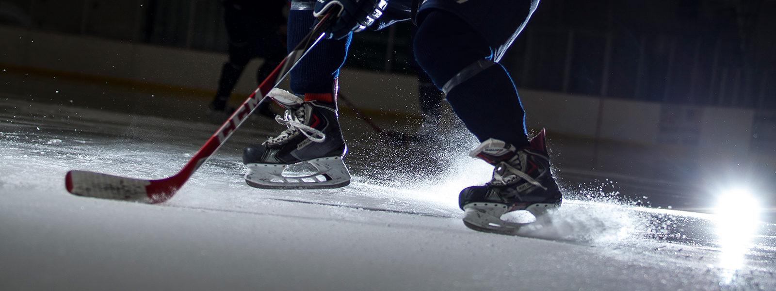 Northland hockey player hitting the puck.