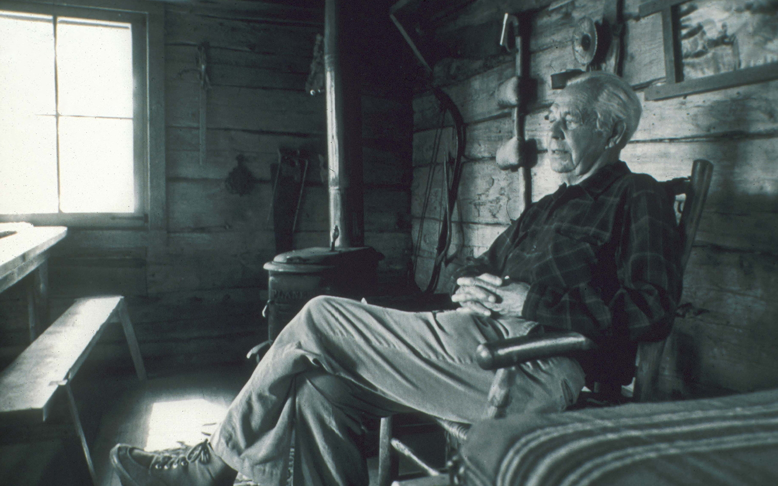 Sigurd Olson sitting on a porch