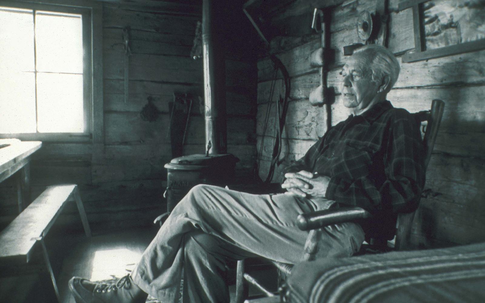 Sigurd Olson sitting on a porch