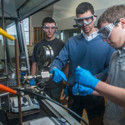 Northland College chemistry prof and students in lab.