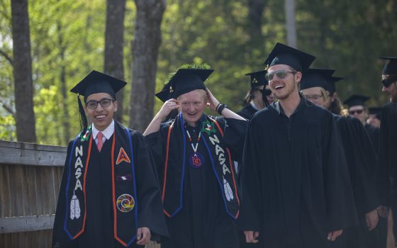 Northland College graduates in cap and gown