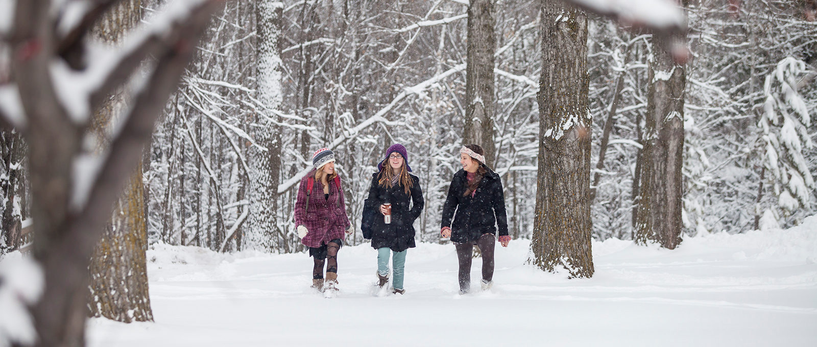 girls walking in snow
