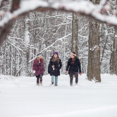 girls walking in snow