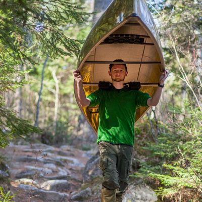Northland student portaging canoe