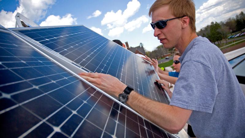 Student working on solar panels