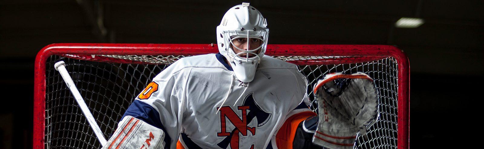 Northland College goalie blocks puck