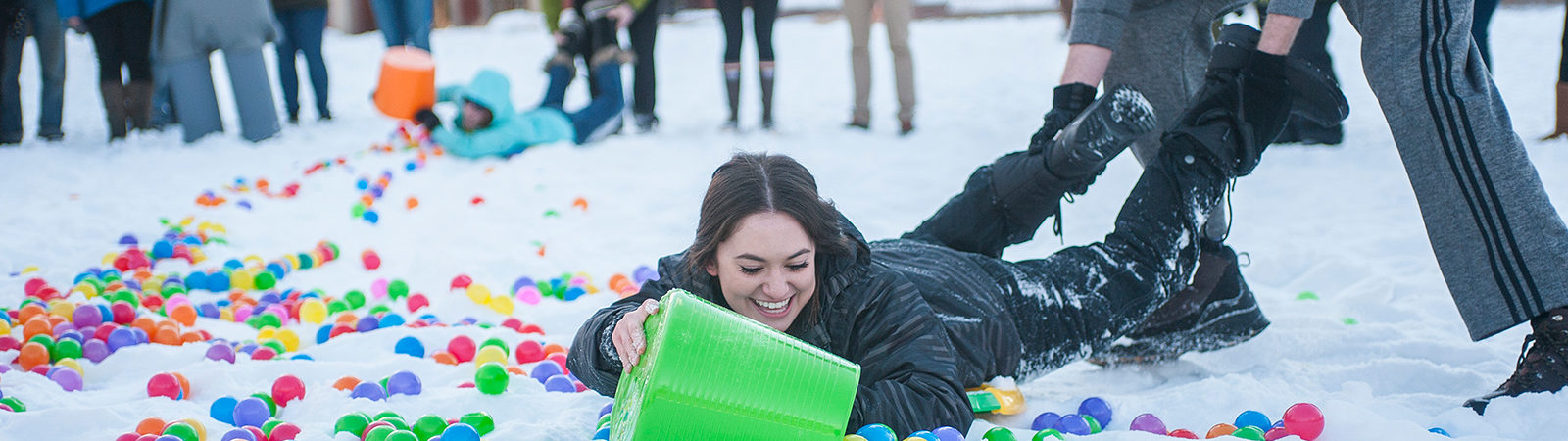 Students compete in Hungry Hungry Hippo game
