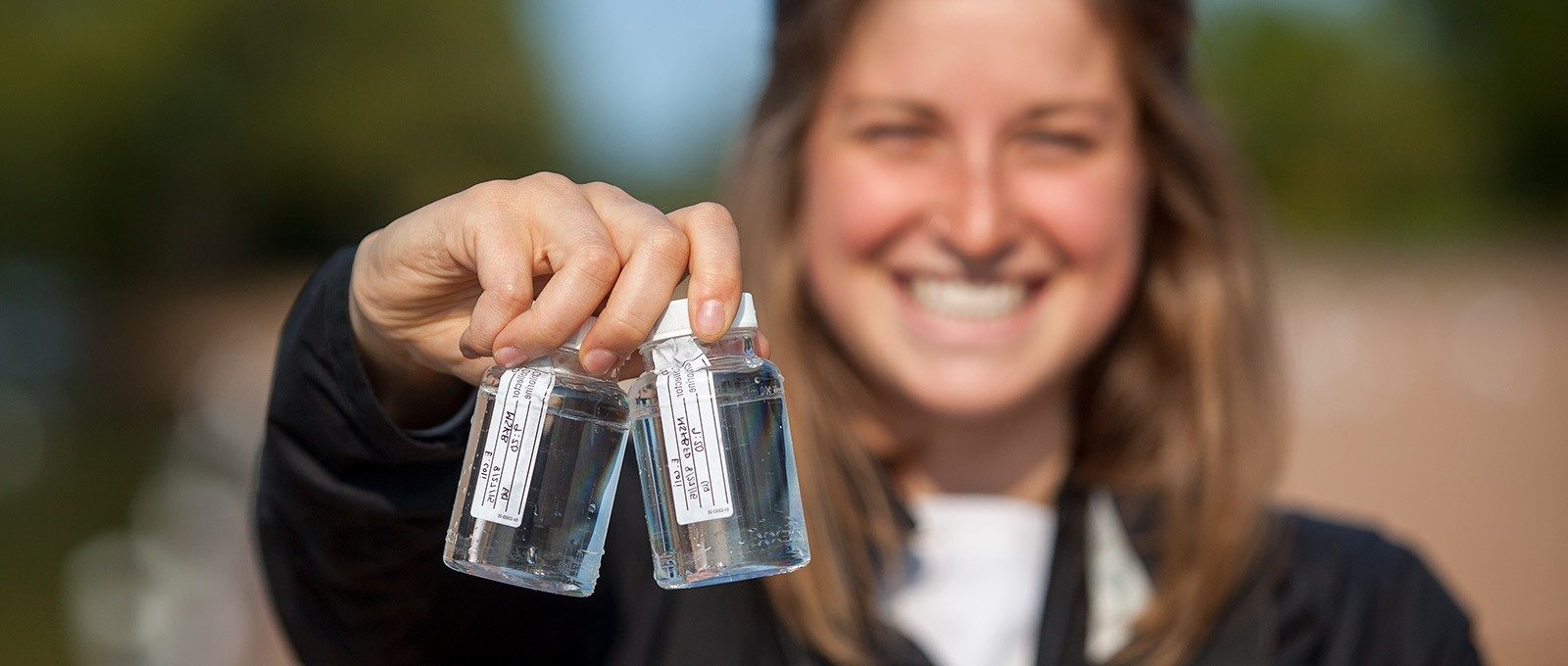 student with water samples