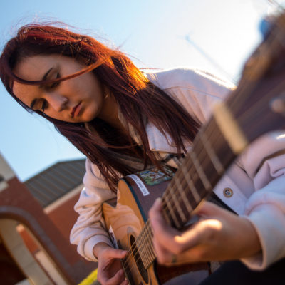 Northland College student Hattie Hoffman plays guitar
