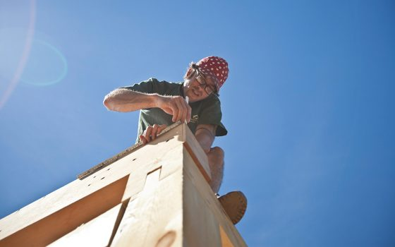 Man working on timber frame building