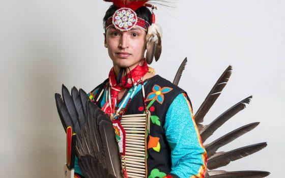 Northland College senior at powwow