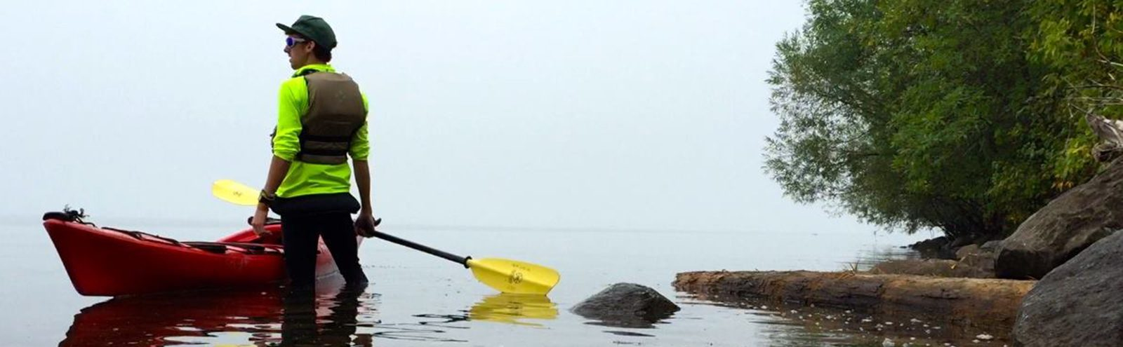Northland student stands in Lake Superior