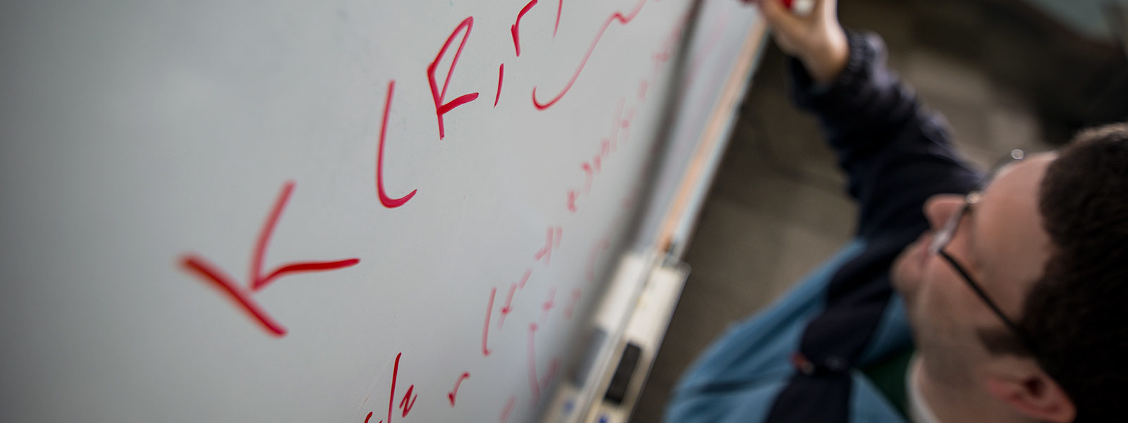 Whiteboard with math formulas