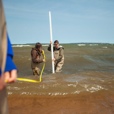 Students measure waves at beach