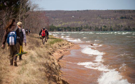 Students hike along beach