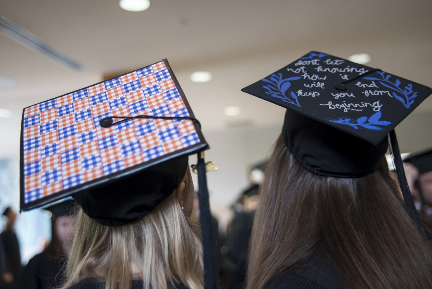 Two decorated hats at commencement