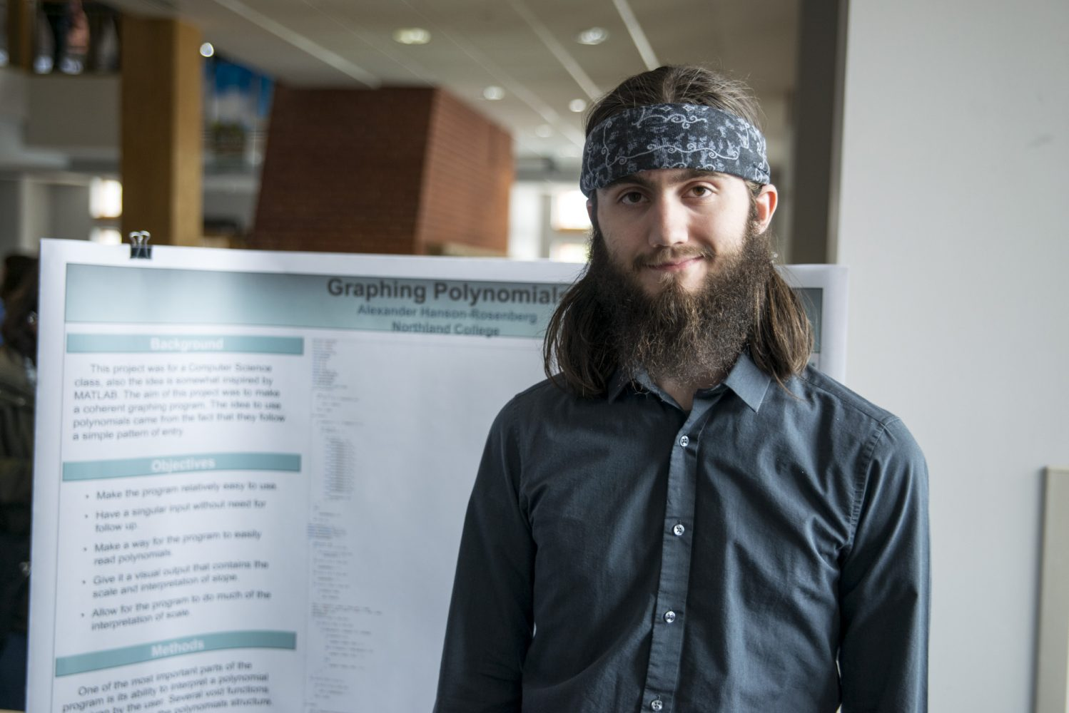 Northland student in front of poster session.