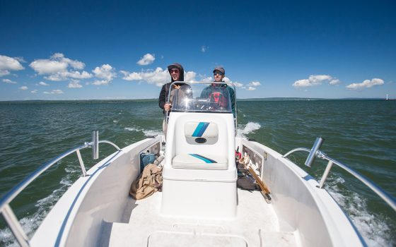 Joe Fitzgerald and Randy Lehr drive boat to islands