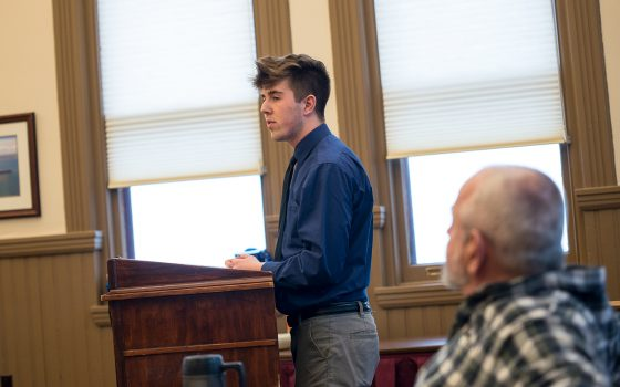 Student at city hall meeting