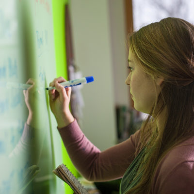 Northland College student Kaylee Thornley at whiteboard