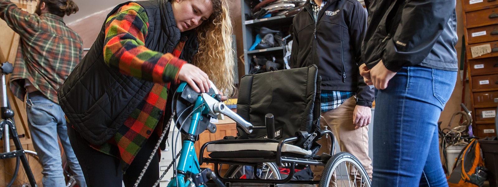 Students work on adaptive bike