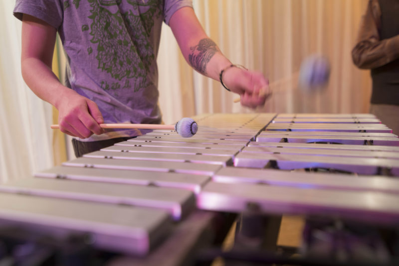 Student playing percussion