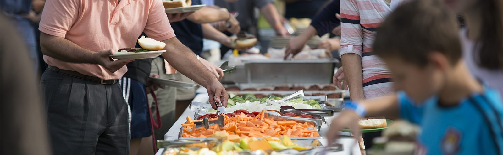 Northland College faculty eat at outdoor buffet