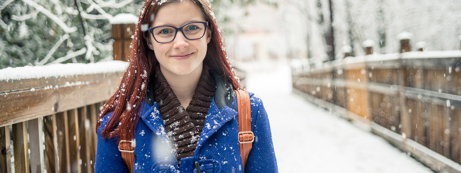 Northland College student in the snow