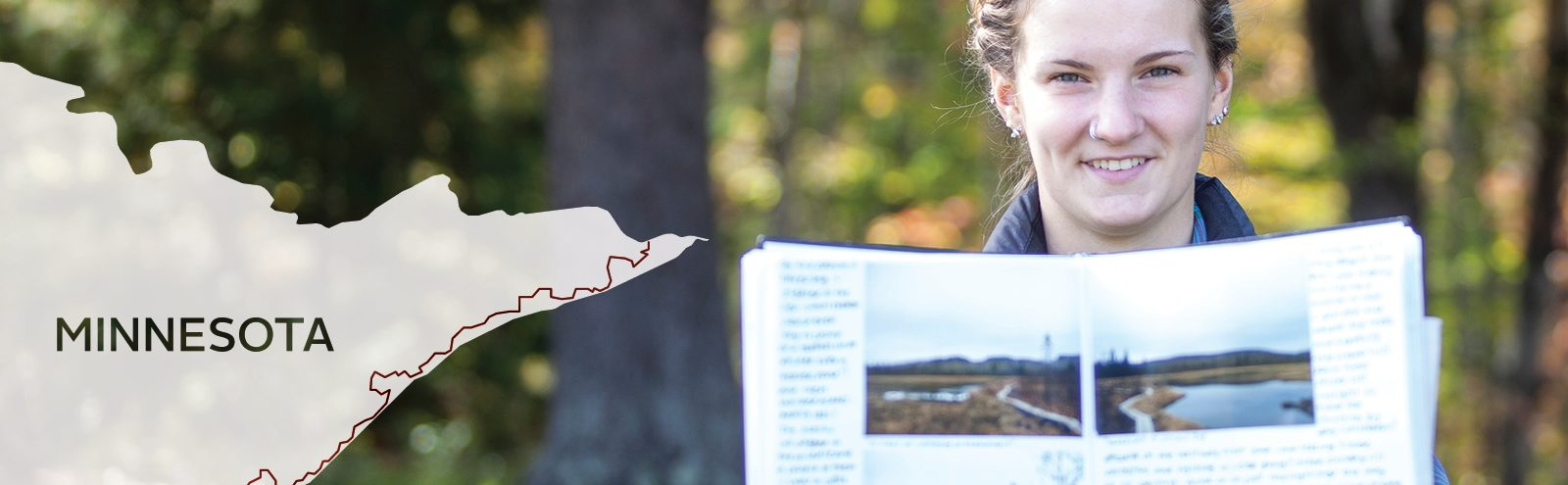 Northland student with journal plus map of hiking trail