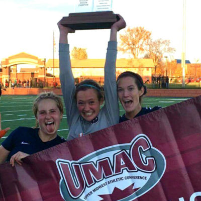 Women's soccer celebrating their UMAC conference title