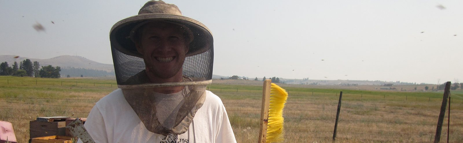 Northland College alum in bee helmet