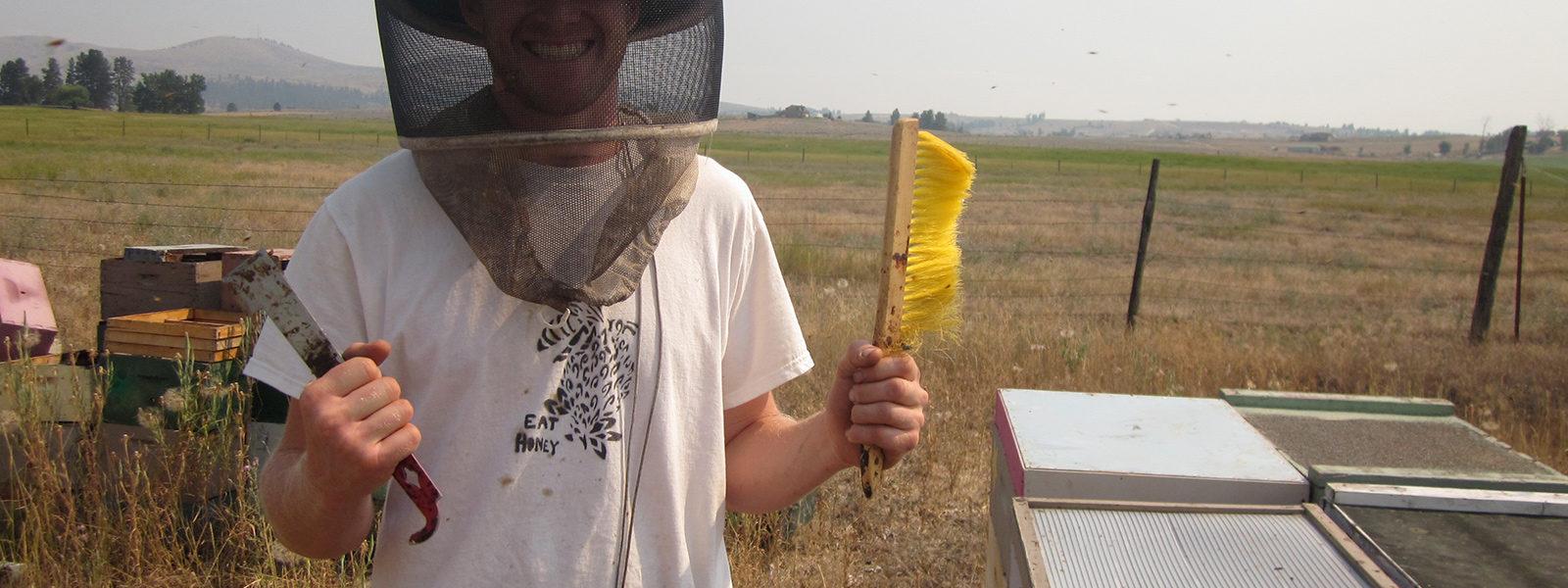 Northland College alum in bee helmet