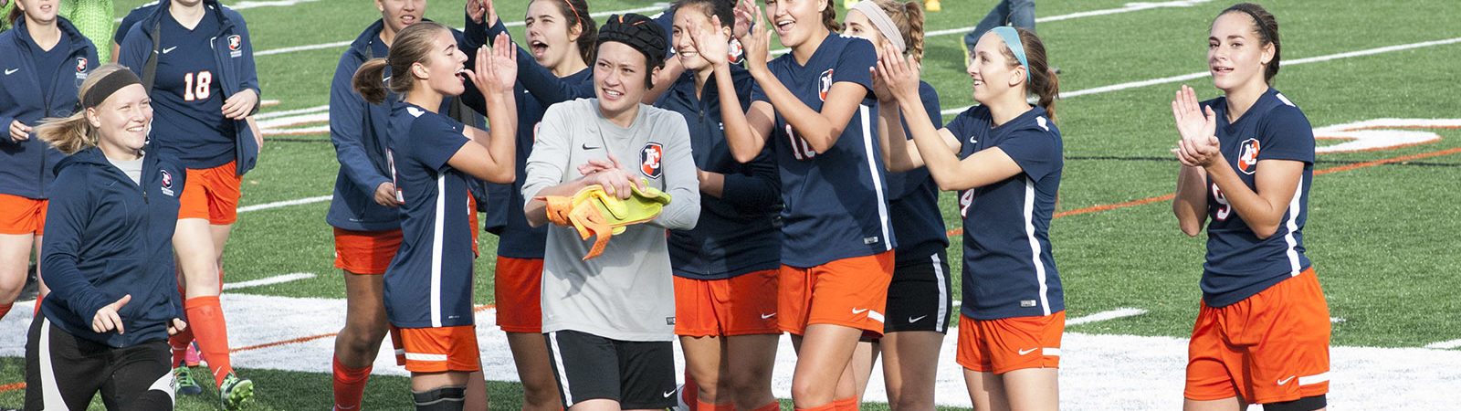 The women's soccer team celebrates winning in the playoffs
