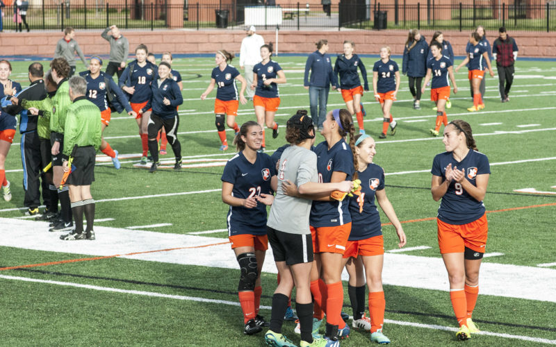 Northland College women's soccer team celebrates victory