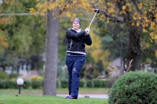 Northland College student plays golf.
