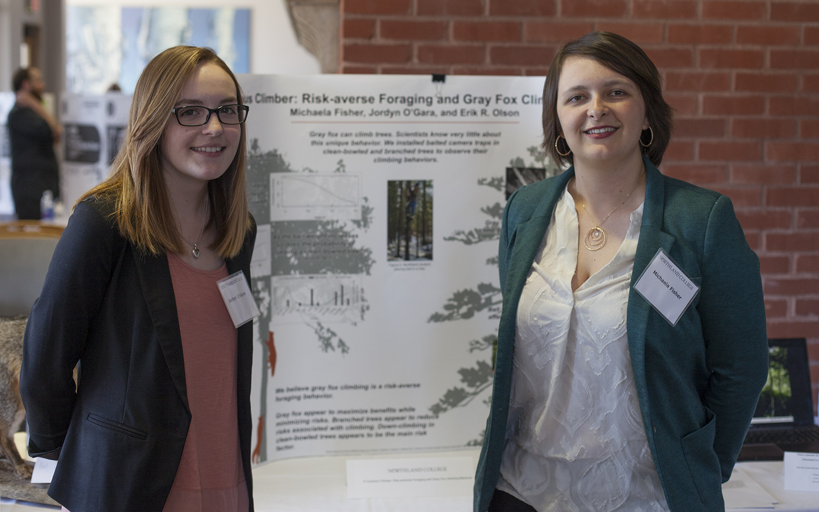Northland College students present original research on gray fox behaviors.