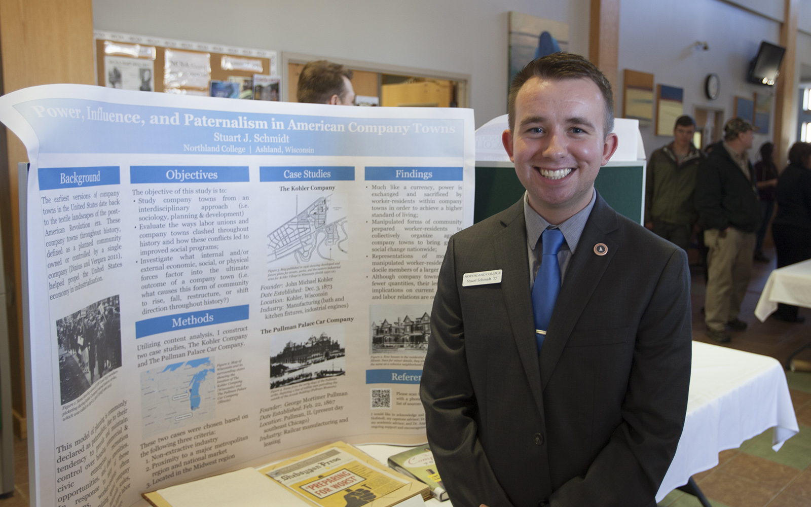 Northland College student presents research on company towns.
