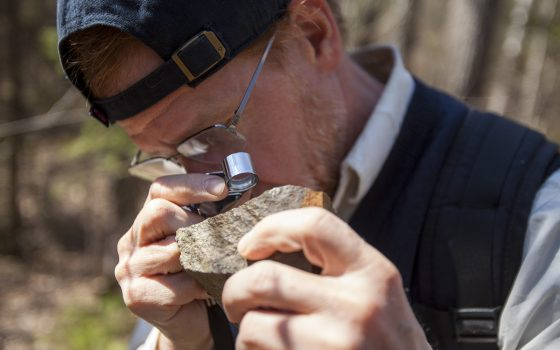Tom Fitz looking at rock