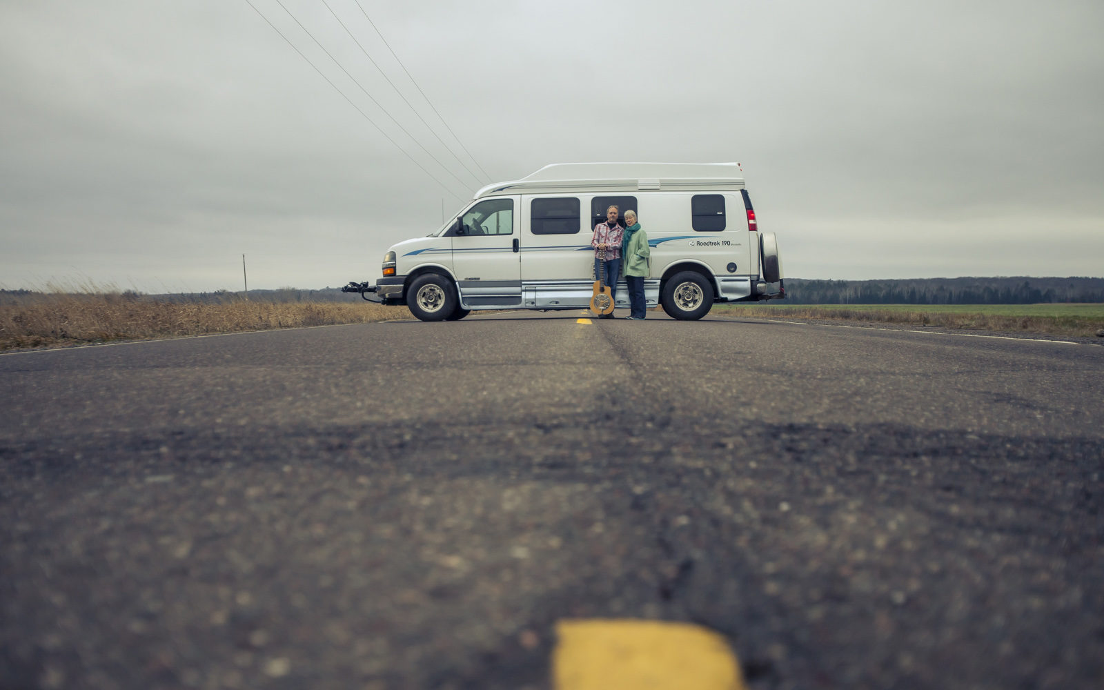 Northland College alumni Linda Rise and Andy Noyes stand in front of their van
