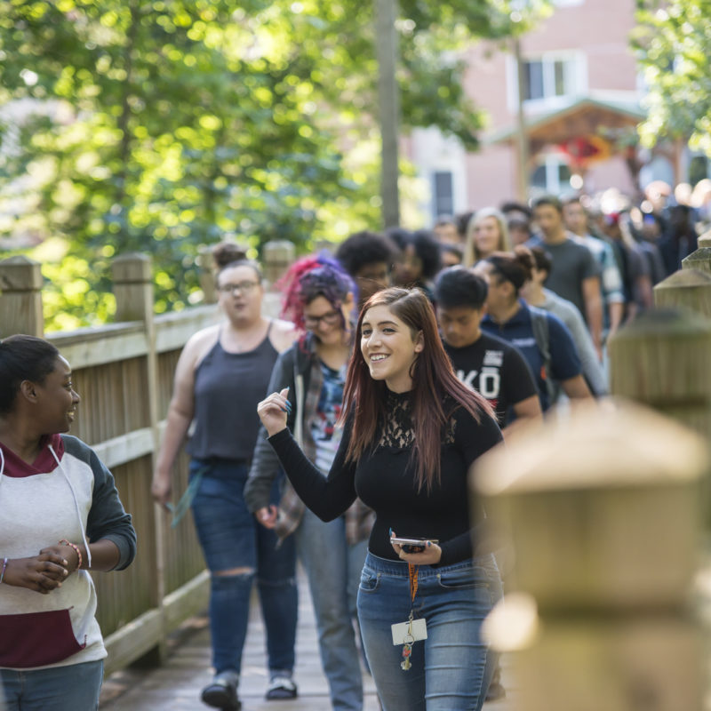 Northland College students cross bridge as part of convocation.
