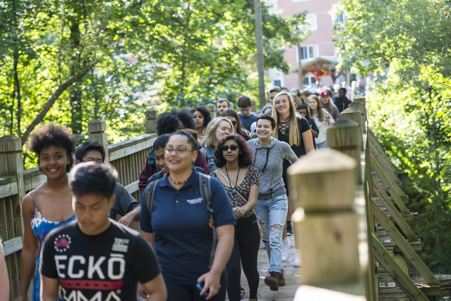 Northland College Class of 2021 students cross the bridge as part of convocation.