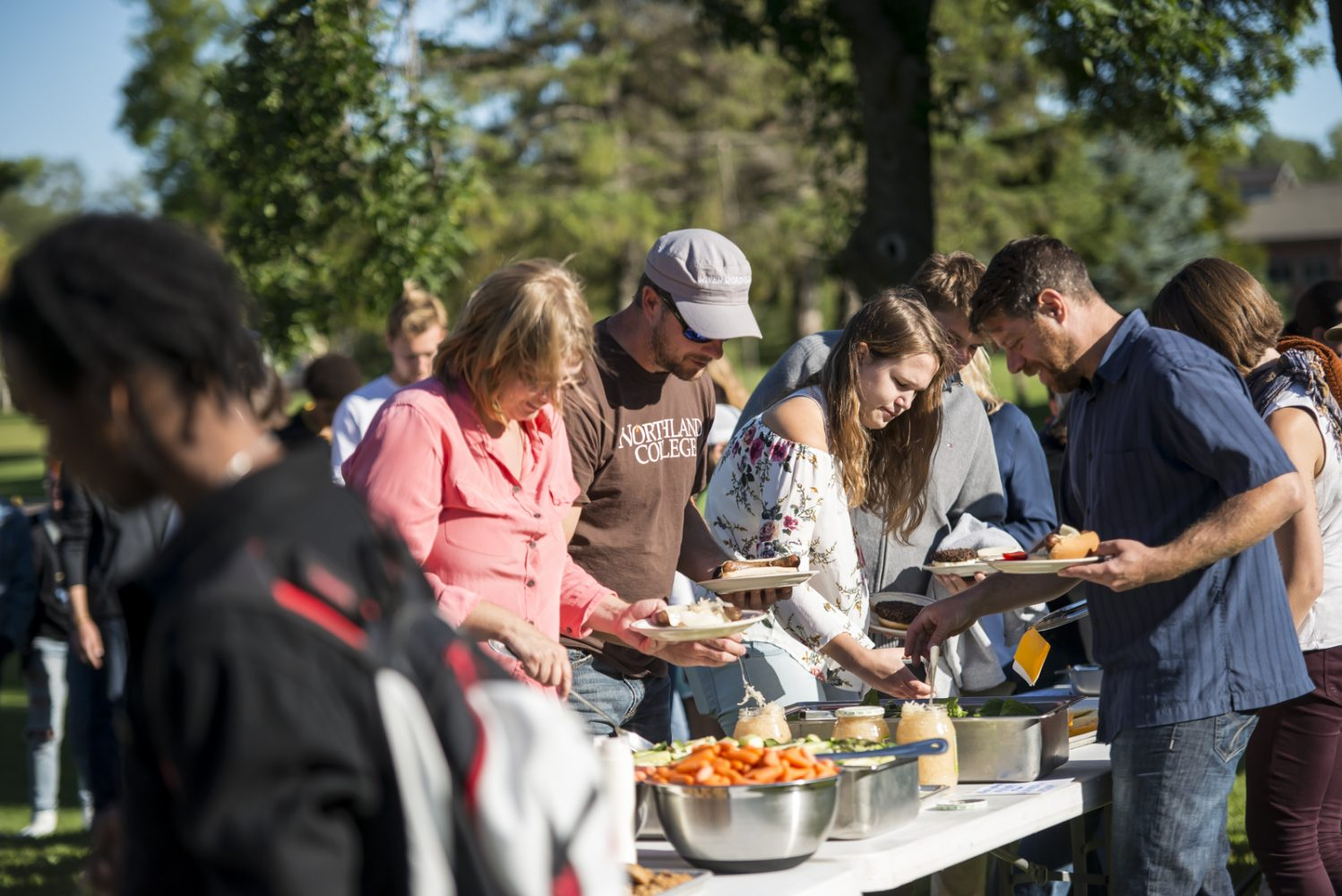 Northland College staff and faculty get dinner at the Everybody Party on campus.