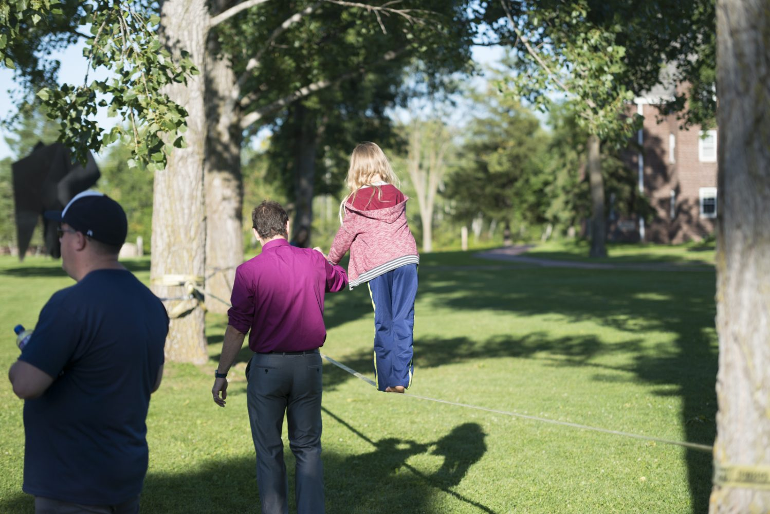 Young boy walks the slack line at Northland College Convocation and Everybody Party.