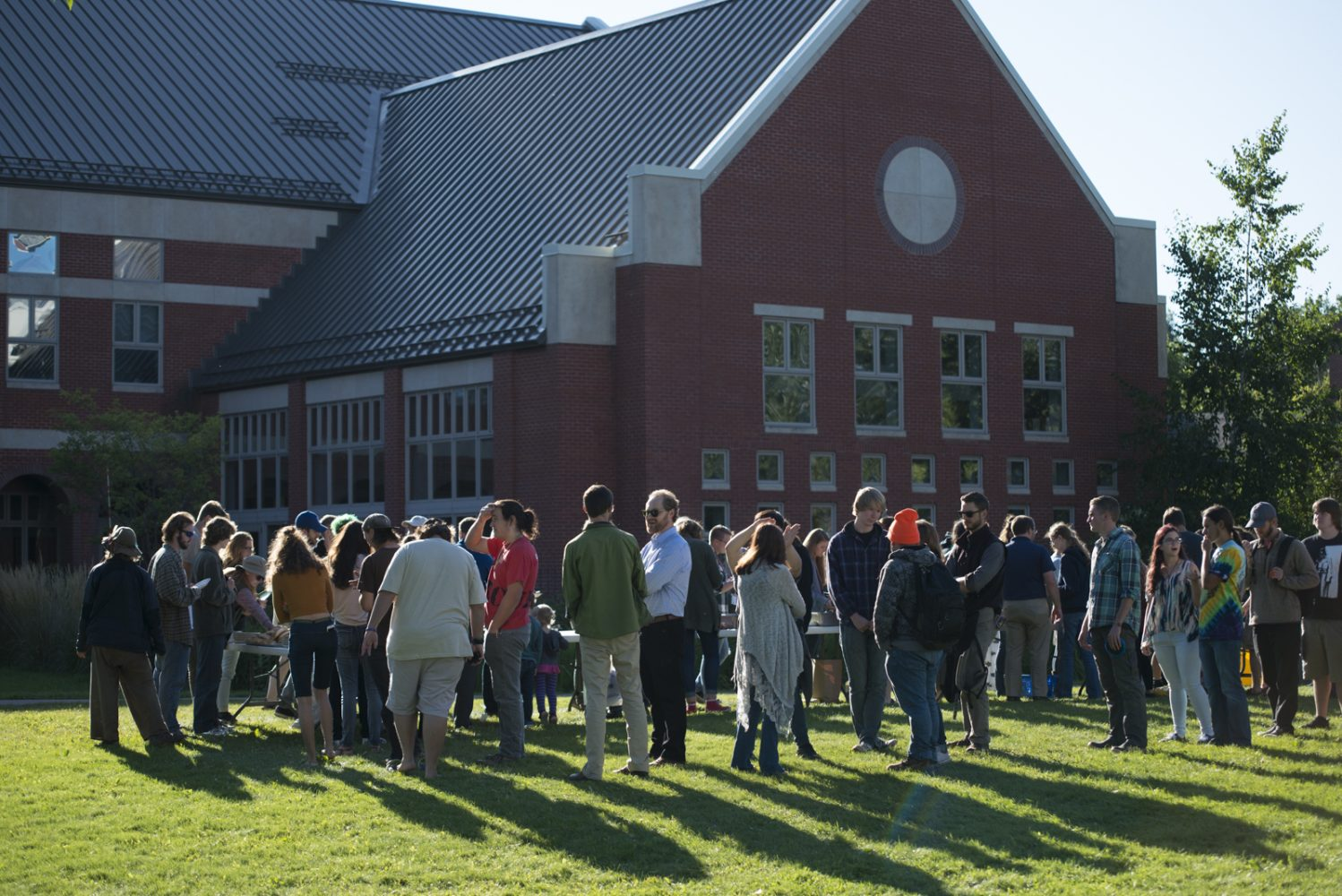 Northland College students and faculty line up for dinner at the Everybody Party on campus.