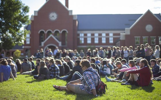 Northland College students on campus mall lawn.