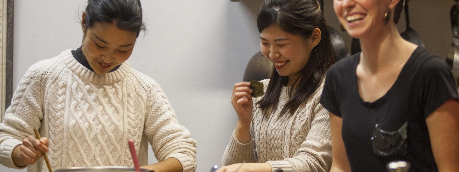 Northland College Japanese exchange students share a laugh with Northland College alumnus Liz Windett